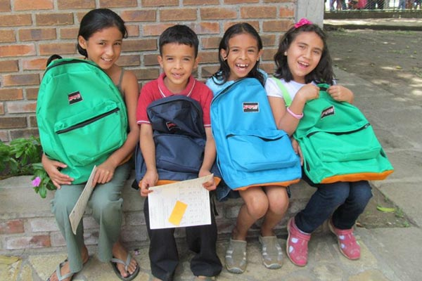 Nicaraguan children show off their new back packs